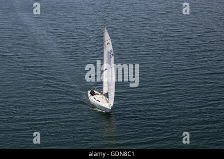 Copenhagen, Denmark - May 06, 2016: Elderly couple sailing in their sailboat. - Stock Photo