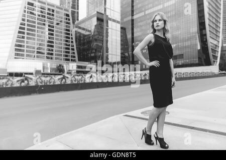 Black and white portrait of business woman in full growth Stock Photo