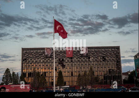Posters and Turkish flags at rally in support of Akp government after a failed coup attempt, Taksim, Istanbul Turkey, - Stock Photo
