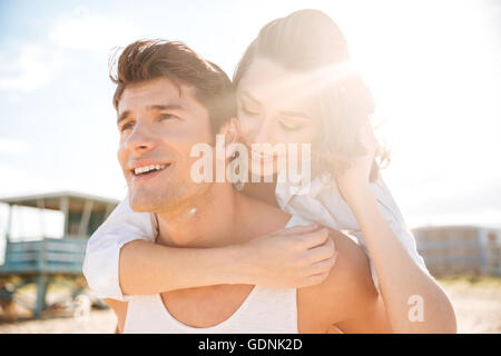 Closeup of happy young couple on the beach - Stock Photo
