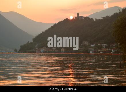 Sunset on Rocca Martinengo, Montisola, Lake Iseo (Italy) during the Floating Piers - Stock Photo