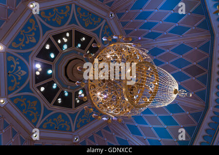 View from below at the crystal chandelier inside of Cinderella's castle. Disneyland Tokyo, Japan - Stock Photo