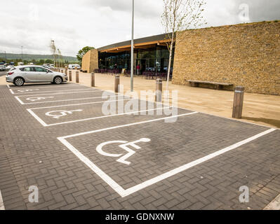 Unoccupied parking bays for disabled persons verhicles - Stock Photo