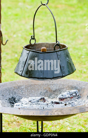 how to clean a pot blackened from campfire