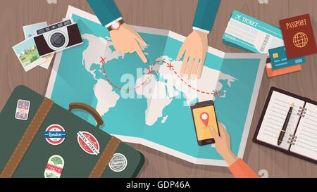 Couple planning a trip around the world, he is pointing on a map and she is using a mobile app, vacations and holidays - Stock Photo