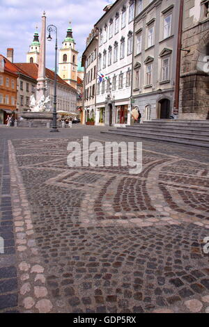 The cobbled streets in the old town with St Nicholas Church in the background,  Ljubljana, Slovenia - Stock Photo