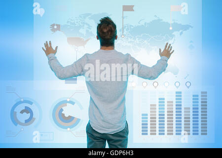 Man preparing presentation on graphical screen, rear view - Stock Photo