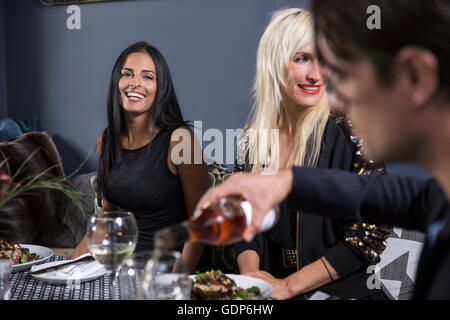 Friends dining in restaurant - Stock Photo