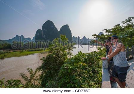Couple admiring Li Jiang river, Guangxi, China - Stock Photo