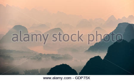 Morning mist over Karst Mountains of Guangxi and Yangshuo, China - Stock Photo