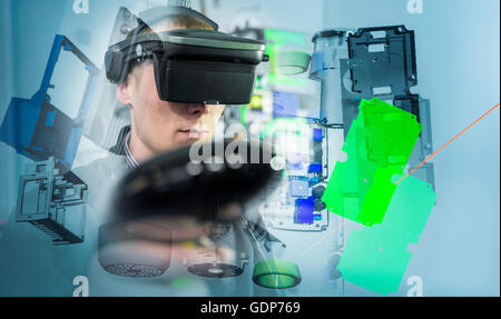 Composite image of engineer wearing VR headset in virtual reality suite - Stock Photo