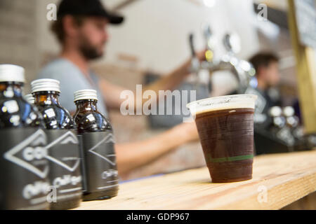Cold brew coffee on cooperative food market stall - Stock Photo