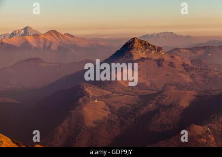 Elevated view of mountains at dusk, Monte Generoso,Ticino, Switzerland - Stock Photo