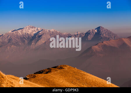 Elevated landscape with snow capped mountains, Monte Generoso,Ticino, Switzerland - Stock Photo