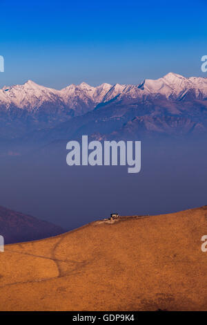Elevated landscape with mist and snow capped mountains, Monte Generoso,Ticino, Switzerland - Stock Photo