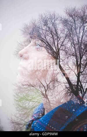 Young woman, side view and trees - Stock Photo