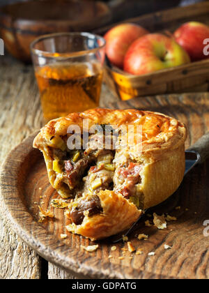 Pork, bacon, cider and buttered leek pie - Stock Photo