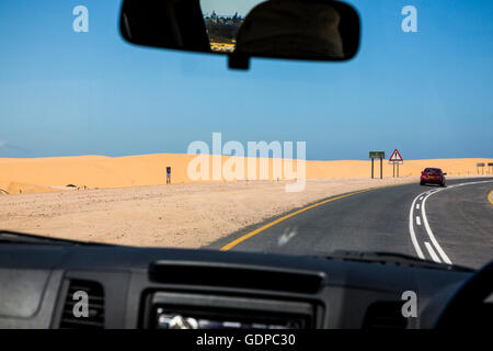 Driving through the Namib Desert between Swakopmund and Walvis Bay - Stock Photo