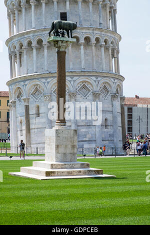 Pillar with statue of Romulus and Remus suckling on a wolf, in the Campo dei Miracoli, in front of the leaning tower, - Stock Photo