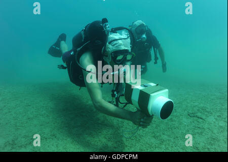 July 8, 2010 - U.S. Navy Explosive Ordnance Disposal Technician uses an AN/PQS 2A handheld sonar device during training - Stock Photo