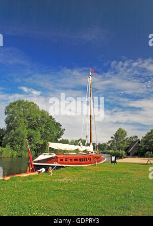 A view of the Norfolk Pleasure Wherry, Hathor, moored on the Norfolk Broads at How Hill, Ludham, Norfolk, England, - Stock Photo