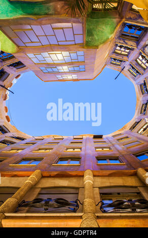 View of inner courtyard, Casa Mila, La Pedrera, Barcelona, Catalonia, Spain - Stock Photo