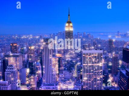 Manhattan skyline at night in New York city - Stock Photo