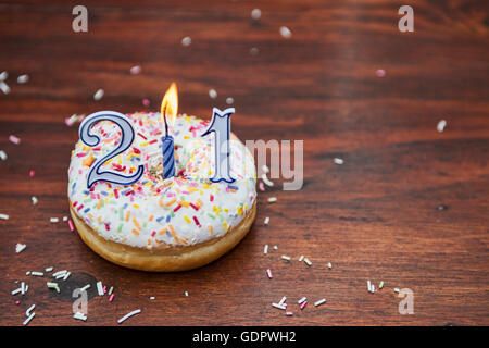 Single birthday donut and candle - Stock Photo