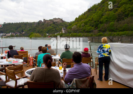 Passengers gather on Viking Alruna's Aquavit Terrace for views of the castle-lined Rhine Gorge during a voyage from - Stock Photo