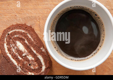 Slice of chocolate cake with a coffee viewed from above - Stock Photo