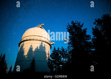 Rozhen astronomical observatory under the night sky stars. Blue sky with hundreds of stars of the Milky way. Observatory - Stock Photo