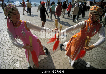 Traditional Women at the Chinese newyear in Hong Kong in the south of China in Asia. - Stock Photo