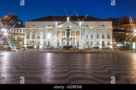 National Theatre D. Maria II, fountains, Rossio Square, paving stones in waveform, wave pattern, night scene, blue - Stock Photo