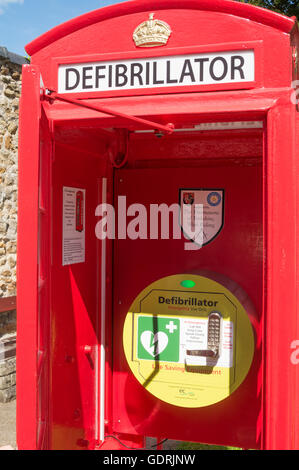 A defibrillator within a telephone kiosk. Waddington , Lancashire, England, UK - Stock Photo