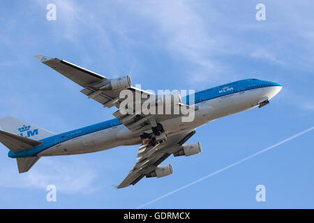 AMSTERDAM, THE NETHERLANDS - FEBRUARY  18, 2015 : Boeing 747 took off from the runway at Schiphol wipe his destination - Stock Photo