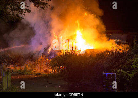 Builth Wells, Powys, Wales, UK. 20th July, 2016. Fire in straw stack at the Royal Welsh Show, Builth Wells. The - Stock Photo