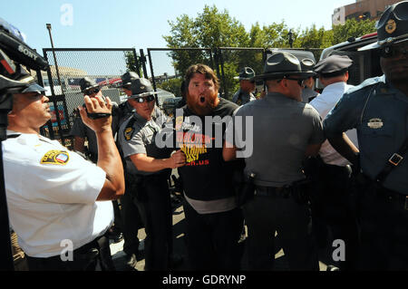 Cleveland, Ohio, USA. 20th July, 2016. A member of the Revolutionary Communist Party is arrested after the group - Stock Photo