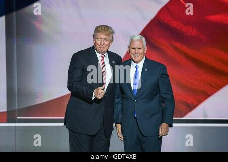 GOP Presidential nominee Donald Trump congratulates his running mate Gov. Mike Pence after Pence formally accepted - Stock Photo