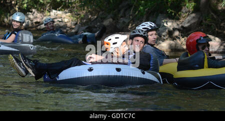 Tube to Work Day: a unique event during  which residents ride inner tubes and other flotation devices on Boulder - Stock Photo