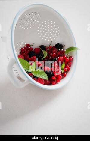 Fresh summer fruits in a colander - Stock Photo