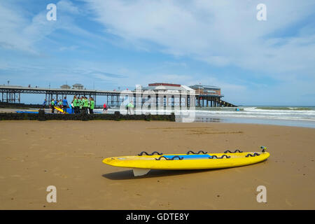 Lifeguard's rescue board on the beach at Cromer in Norfolk - Stock Photo