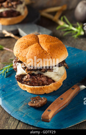 Homemade Grassfed Mushroom and Swiss Cheese Hamburger with Fries - Stock Photo