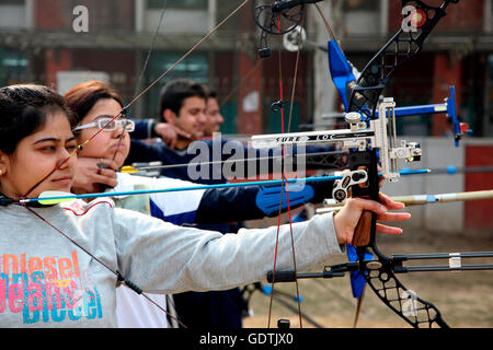 Archers & archery equipment at an archery contest at the University of Delhi, India. - Stock Photo