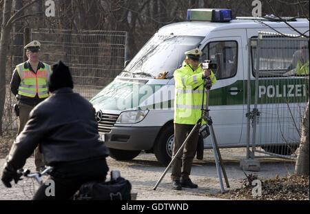 Police check with laser gun - Stock Photo