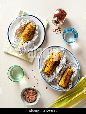 Grilled corn in aluminum foil - Stock Photo
