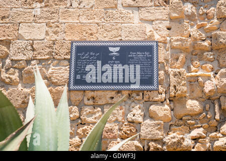 Israel Akko Acre Old City Town Wall typical tourist sign in Hebrew , Arabic & English - Stock Photo