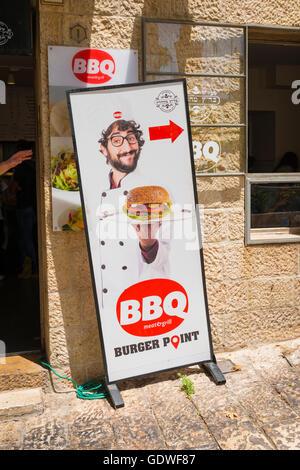 Israel Jerusalem Old City Jewish Quarter Hurva Square snack bbq meat & grill bar Burger Point advert street board - Stock Photo