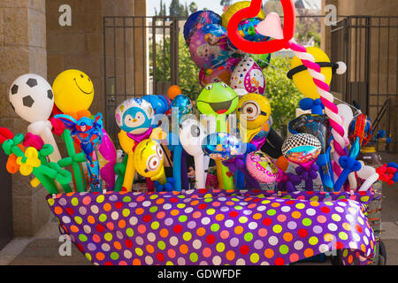 Israel Jerusalem City Center Centre Mamilla Mall bright colourful colorful display stall of novelty balloon balloons - Stock Photo