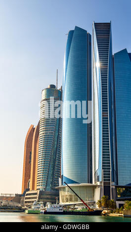 Cluster of skyscrapers in Abu Dhabi, UAE - Stock Photo