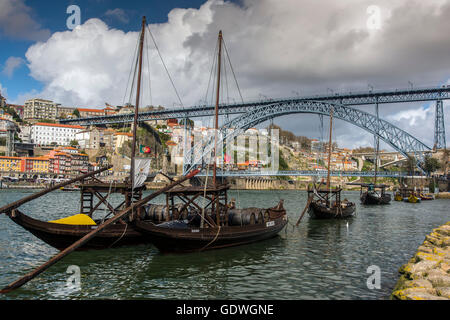 Traditional Rabelo boats with Dom Luis I bridge behind, Porto, Portugal - Stock Photo